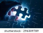 hand insert jigsaw  conceptual... | Shutterstock . vector #296309789