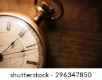 old pocket watch on grungy... | Shutterstock . vector #296347850