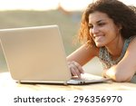 Happy Woman Using A Laptop In ...