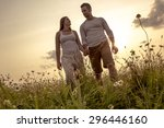 a young couple in love outdoor... | Shutterstock . vector #296446160