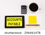 Small photo of Business Term / Business Phrase on Tablet PC with a cup of coffee, Pens, Calculator, and yellow note pad on a White Background - Black Word(s) on a yellow background - Accounts Payable