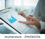 businessmen are analyzing... | Shutterstock . vector #296560256