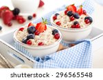 oatmeal with fresh fruits and... | Shutterstock . vector #296565548