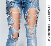 Ripped jeans female feet