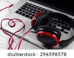 headphones with laptop on table ...   Shutterstock . vector #296598578