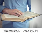 young man reading book close up | Shutterstock . vector #296614244