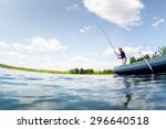 young man fishing on the fresh... | Shutterstock . vector #296640518