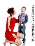 beautiful young mother in a red ... | Shutterstock . vector #296662868