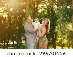 image of happy family of three... | Shutterstock . vector #296701556