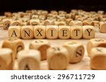 Small photo of ANXIETY word written on wood block