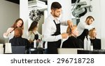 hairdresser cuts young girl's... | Shutterstock . vector #296718728