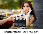 Small photo of Surprised Actress Shooting Movie Scene - Young professional cinema star acting in a film