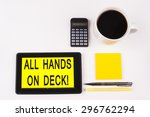 Small photo of Business Term / Business Phrase on Tablet PC with a cup of coffee, Pens, Calculator, and yellow note pad on a White Background - Black Word(s) on a yellow background - All Hands On Deck