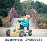 young boy driving pedal go kart ... | Shutterstock . vector #296800166