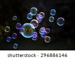 rainbow soap bubbles on a dark... | Shutterstock . vector #296886146