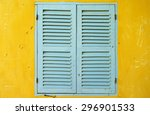 Old Wooden Window On Yellow Wall