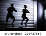 muscular couple doing jumping... | Shutterstock . vector #296937869