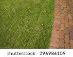 A Brick Pathway Next To A Grass ...