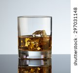 glass of scotch whiskey and ice  | Shutterstock . vector #297031148