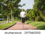 man running on a track in a... | Shutterstock . vector #297060350