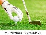 Hand Putting Golf Ball On Tee...
