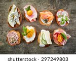 Various Bruschettas On Wooden...
