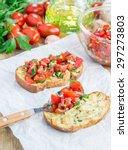 bruschetta with tomatoes  herbs ... | Shutterstock . vector #297273803