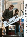Small photo of HAMPTON, GA - FEBRUARY 28: A musician holds a Roland Lucina synthesizer like a guitar while playing in a concert outside Atlanta Motor Speedway before a race, on February 28, 2015 in Hampton, GA.