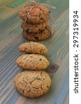 Small photo of Sweetmeats. Two types of oatmeal cookies with sunflower seeds and raisins. Some related cord with bow, a second overlapping ends. Perfect for a day trip, party, meeting over coffee.