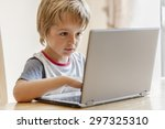 Young Boy Working On Laptop...