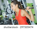 young woman training in the gym | Shutterstock . vector #297335474