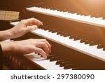 Organist Playing A Pipe Organ ...