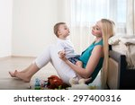 cute mom is sitting on flooring ... | Shutterstock . vector #297400316