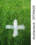 White cross on a green soccer grass - stock photo