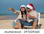 christmas couple on a beach  | Shutterstock . vector #297639260