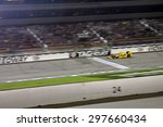 Newton, Iowa USA - July 18, 2015: Verizon IndyCar Series Iowa Corn Indy 300. Ryan Hunter-Reay wins at Iowa for the third time. Checkered flag at the night race. - stock photo