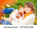 woman with child in autumn park....   Shutterstock . vector #297691538