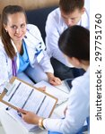happy medical team discussing... | Shutterstock . vector #297751760