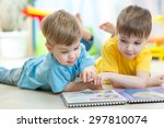 Two Kids Boys Reading A Book...