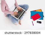 Young Female Student Sitting...