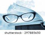 reading glasses and books over... | Shutterstock . vector #297885650