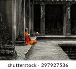 A Monk Meditates At The Angkor...