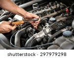 mechanic using a wrench and... | Shutterstock . vector #297979298