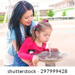 young mother gives drink to his ... | Shutterstock . vector #297999428