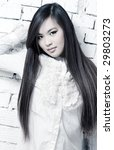Young woman on wall background. Bright white colors. - stock photo