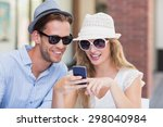 cute couple looking at a... | Shutterstock . vector #298040984