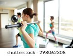 Small photo of fitness, sport, people and lifestyle concept - close up of sportsmen exercising with bars and step platforms in gym