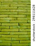 Small photo of Brick background in olive-drab color