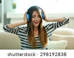 Woman Listening Music In...