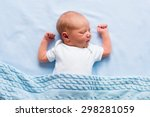Newborn Baby Boy In Bed. New...
